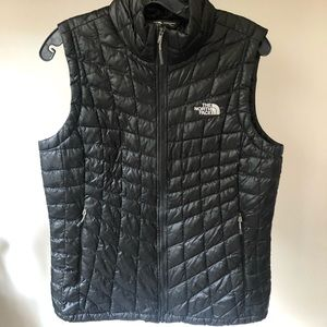 The North Face black puffy vest size medium